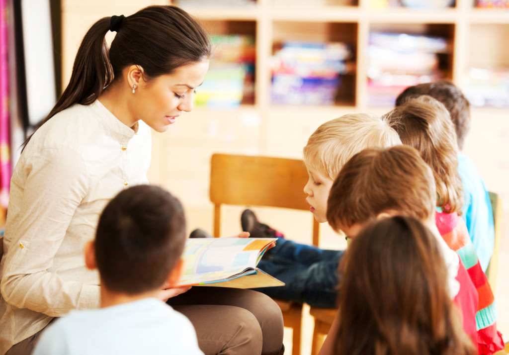 Nursery teacher reading a story to the group of kids. [url=http://www.istockphoto.com/search/lightbox/9786682][img]http://dl.dropbox.com/u/40117171/children5.jpg[/img][/url] [url=http://www.istockphoto.com/search/lightbox/9786738][img]http://dl.dropbox.com/u/40117171/group.jpg[/img][/url]